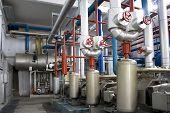 foto of dynamo  - Industrial size generators in a factory machinery room - JPG