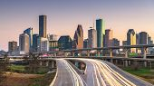 Houston, Texas, USA downtown city skyline and highway at dusk. poster