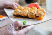 Cook Hands Making Japanese Sushi Roll. Japanese Chef At Work Preparing Delicious Sushi Roll With Eel poster