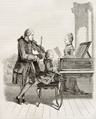 stock photo of mozart  - Mozart wonder child with his father and sister in 1763 - JPG