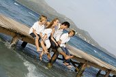 stock photo of family fun  - happy healthy family relaxing on summer vacation in malllorcas spain - JPG