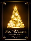image of weihnacht  - Warmly sparkling Christmas tree made of our of focus  lights on dark brown background with the text  - JPG