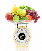 Low fat concept. Kitchen scale with fruits and vegetables