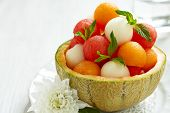 image of cantaloupe  - Fruit salad with melon and watermelon balls in cantaloupe bowl - JPG