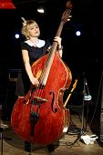 picture of bonaparte  - Beautiful woman in black dress plays wooden contrabass in night club - JPG
