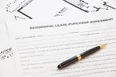 picture of rental agreement  - Business Document of Residential lease- purchase agreement ** Note: Shallow depth of field - JPG
