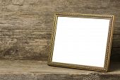 Empty photo frame on a wooden background