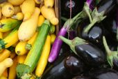 image of farmers market vegetables  - Locally grown produce (zucchini and eggplant) at a farmer