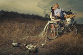 image of married  - Groom and bride on a bicycle with just married sign and cans attached - JPG