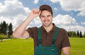 pic of dungarees  - Happy young gardener in dungarees - JPG