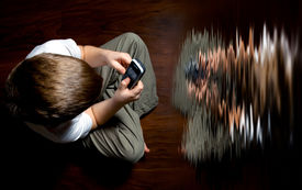 picture of pep talk  - The boy sits on the floor with a mobile phone in the hands - JPG