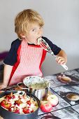 pic of pie-in-face  - cute little child helping and baking apple pie in home - JPG