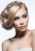 stock photo of tiara  - Beautiful blond girl in the image of a bride with a tiara in her hair - JPG