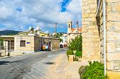 stock photo of neo  - The street leads to the St Minas church located on the central village square Neo Chorio Cyprus - JPG