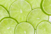 stock photo of lime  - Natural green fresh lime slices close up background - JPG