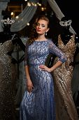 image of dress mannequin  - fashionable woman posing in blue dress with rhinestones and mannequins - JPG