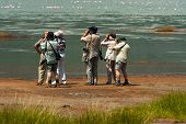 foto of safari hat  - Group of seniors on photo safari in Africa observing animals - JPG