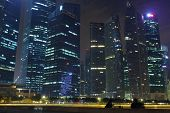 stock photo of singapore night  - skyline of singapore in night time with silouhette people talking - JPG