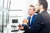 stock photo of trade  - Successful businessmen trading stocks - JPG