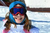 pic of winter season  - A portrait of a happy young girl in the ski resort during winter ski season - JPG