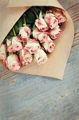 foto of bunch roses  - Bunch of beautiful roses packed in paper - JPG