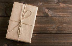 image of packages  - parcel wrapped packaged box on wooden background - JPG