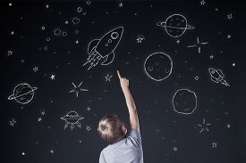 pic of boys night out  - Little boy pointing at drawing sky at night - JPG