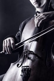 stock photo of cello  - Cellist playing classical music on cello - JPG