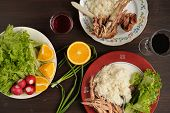 picture of scallion  - Dinner od turkey meat with rice lettuce salad with radish oranges and scallion red wine on dark background top view horizontal - JPG