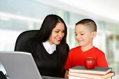 foto of schoolboys  - Schoolboy and teacher looking at laptop and talking - JPG