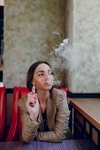pic of electronic cigarette  - beautiful elegant young woman smoking electronic cigarette - JPG