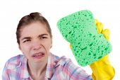 stock photo of stereotype  -  housewife in gloves with sponge and detergent - JPG