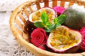 image of passion fruit  - Passion fruits in basket on color wooden background - JPG