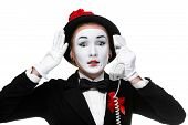 picture of mime  - business woman as mime holding a handset - JPG