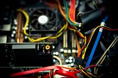 pic of capacitor  - Old dusty pc motherboard capacitor with cables and fan selective focus in vintage color effect - JPG