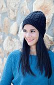 stock photo of piercings  - Pretty brunette girl with wool cap and piercing - JPG