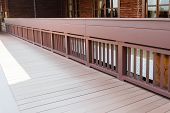 foto of bannister  - the bannister of wooden walkway on the terrace - JPG