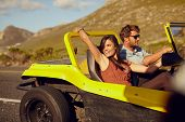 picture of car ride  - Relaxed couple enjoying in the car ride - JPG