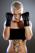 picture of martial arts girl  - Portrait of a professional athlete woman bodybuilder with a perfect athletic physique - JPG