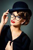 pic of bowler hat  - Beautiful woman wearing glasses and bowler hat - JPG