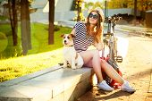 picture of fitness-girl  - Smiling Hipster Girl with her Dog and Bike in the City - JPG