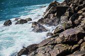 pic of breaker  - Photo of the water breaker on stones rocks  - JPG