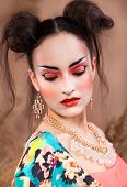 foto of geisha  - Close up stylized portrait of a Japanese geisha with bright make up - JPG