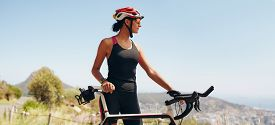 stock photo of sportswear  - Image of determined female cyclist looking away - JPG