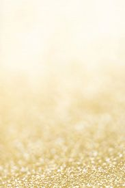 picture of glitter  - Holiday abstract glitter background with blinking lights and gold defocused texture - JPG