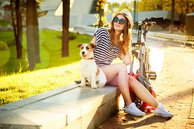 image of urbanization  - Smiling Hipster Girl with her Dog and Bike in the City - JPG