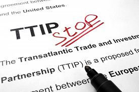 stock photo of lobbyist  - Words TTIP stop on a paper and marker - JPG