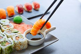 stock photo of soy sauce  - Sushi Maki and Niguiri with soy sauce and wasabi with California Roll - JPG