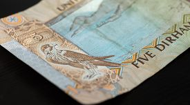 stock photo of dirhams  - Banknote of the United Arab Emirates in five dirhams close up - JPG