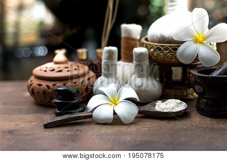poster of Thai Spa massage compress balls herbal ball and treatment spa relax and healthy care with flower Thailand. Healthy Concept. select focus